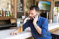 Mixing Alcohol With Phone Call Is A Risky Game royalty free stock photography