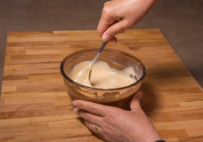 Mixing Batter in a Glass Bowl royalty free stock photo