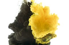 Mixing of black and yellow paint,. Isolated on white stock photo