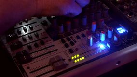 Mixing board with. Control arm. Color music sparkles with colored lights stock video footage