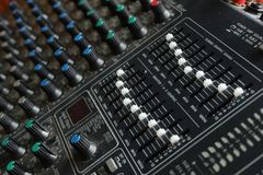 Mixing board with white and blue knobs close up royalty free stock photography