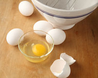 Eggs on cutting board Stock Image
