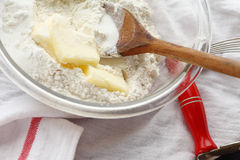 Mixing butter with flour in bowl Royalty Free Stock Photos
