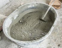 Mixing a cement in salver Royalty Free Stock Photography