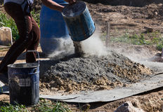 Mixing cement and sand Stock Image