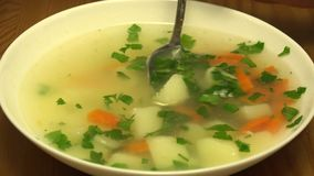 Mixing of Chicken Coconut Soup in Dish. Closeup. 4K UHD, Ultra HD Resolution. stock footage