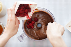 Mixing chocolate and raspberries Stock Images
