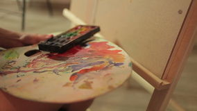Mixing colors in the palette, art, culture stock video