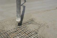 Mixing concrete. Slab construction - Europe Stock Image