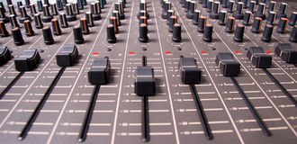 Mixing console. Audio mixing console sliders wide angle shot Stock Photos
