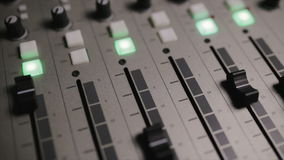 Mixing console also called audio mixer, sound board, mixing deck or mixer is an electronic device stock footage