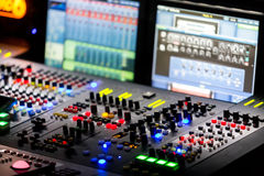 A mixing console, or audio mixer,shallow dof Royalty Free Stock Images
