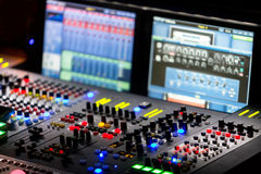 A mixing console, or audio mixer,shallow dof Royalty Free Stock Photo