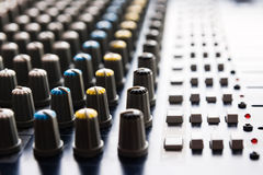 Mixing console. Closeup of a mixing console in a recording studio Stock Photo