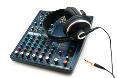 Mixing console and headphones. Stock Photos