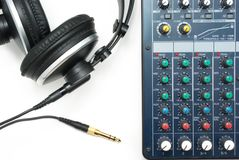 Mixing console and headphones Royalty Free Stock Photos