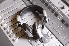 Mixing console and headphones royalty free stock images