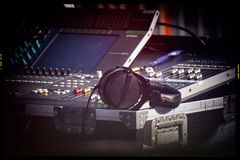 Mixing console. Mixing sound console and monitor headphones in retro style film Royalty Free Stock Image