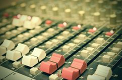 Mixing console. In a sound recording studio stock images