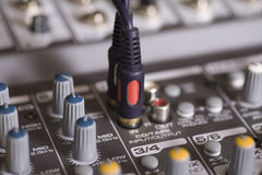 Mixing console with wires plugged in Stock Photo