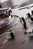 Mixing controller and turntable. Mixer and part of turntable playing the analog record Royalty Free Stock Photos