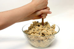 Mixing cookie dough. Hands mixing cookie dough in a bowl Stock Image