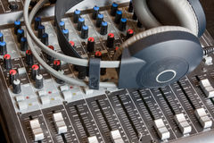 Mixing Desk. A sound mixing desk with a pair of headphones Royalty Free Stock Photography