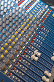 Mixing Desk. Close up of an audio visual mixing desk royalty free stock photography
