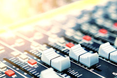 Mixing desk. Background pattern and sunlight effect Royalty Free Stock Images