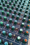 Mixing desk. Audio mixing console in a recording studio Stock Photos