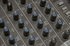 The Mixing Desk. Closeup view of a DJ's mixing desk with shallow depth of field Royalty Free Stock Photos