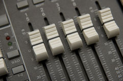 The Mixing Desk. Closeup view of a DJ's mixing desk with shallow depth of field Stock Photo