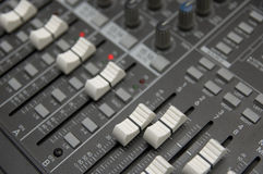 The Mixing Desk. Closeup view of a DJ's mixing desk with shallow depth of field Royalty Free Stock Photography