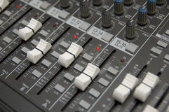 The Mixing Desk. Closeup view of a DJ's mixing desk with shallow depth of field Royalty Free Stock Images