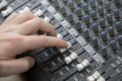 The Mixing Desk. Closeup view of a DJ's mixing desk with shallow depth of field Stock Photos