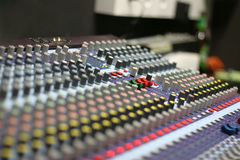 The Mixing Desk. A mixing panel at a live concert Royalty Free Stock Images