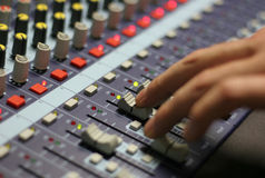 The Mixing Desk. A mixing panel at a live concert Royalty Free Stock Photography