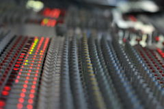 Mixing Desk. Analouge mixing desk working, recording studio, retro, from the nineties Stock Image