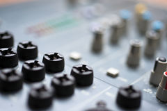 Mixing desk close-up Stock Images