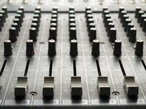 Mixing desk faders and knobs royalty free stock photo