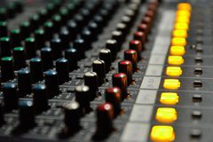Mixing Desk. Sound mixing desk with lights and knobs Stock Photos