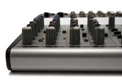 Mixing Desk (Top Front View). Detail shot of a small mixer isolated on white Stock Image