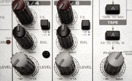 Mixing Desk (Top View). Detail shot of a small audio mixer Royalty Free Stock Photo