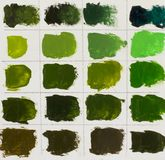 Mixing different colors of paint on the palette. Stock Image