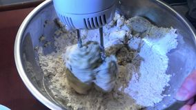 Mixing dough for baking stock video footage