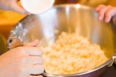 Mixing dough Royalty Free Stock Photos