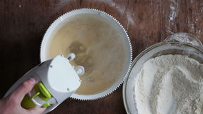 Mixing dough with electric mixer. Cooking at home. stock footage