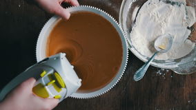 Mixing dough with electric mixer. Cooking at home. stock video footage