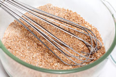 Mixing dry ingredients to prepare integral wheat bran muffins. Wheat bran muffins preparation : Mixing dry ingredients to prepare integral wheat bran muffins Stock Image
