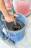 Mixing dry mortar with water by stucco Royalty Free Stock Photos